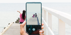 Creating images training hero shot - Children on pier as adult takes a photo